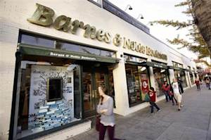 People walk by a Barnes & Noble bookstore in Pasadena