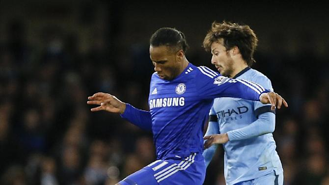Chelsea's Didier Drogba, left, challenges for the ball with Manchester City's David Silva during the English Premier League soccer match between Chelsea and Manchester City at Stamford Bridge stadium in London, Saturday, Jan. 31, 2015. (AP Photo/Kirsty Wigglesworth)