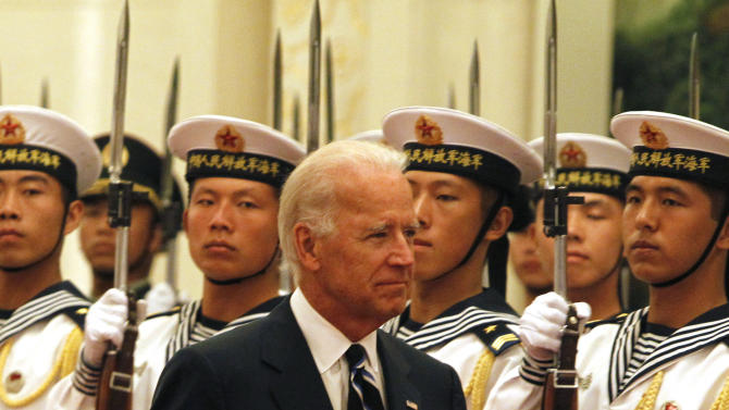 U.S. Vice President Joseph Biden inspects a guard of honor during a welcome ceremony held at the Great Hall of the People in Beijing, China, Thursday, Aug. 18, 2011. (AP Photo/Ng Han Guan)