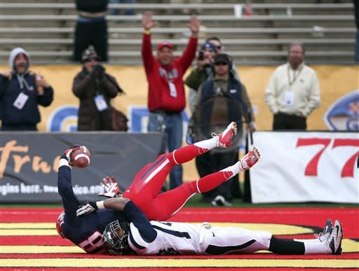 Arizona overcomes Nevada 49-48 in New Mexico Bowl