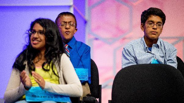 """Dev Jaiswal, second from left, 13, of Jackson, Miss., reacts after correctly spelling """"bacchius"""" during the finals of the Scripps National Spelling Bee, Thursday, May 28, 2015, in Oxon Hill, Md. (AP Photo/Andrew Harnik)"""