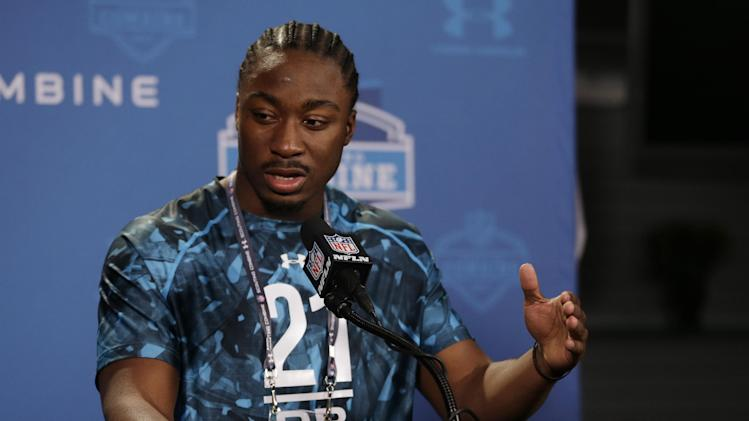 South Carolina running back Marcus Lattimore answers a question during a news conference at the NFL football scouting combine in Indianapolis, Friday, Feb. 22, 2013. (AP Photo/Michael Conroy)