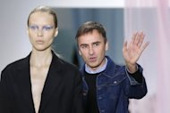 "Newly-minted Christian Dior designer Raf Simons acknowledges the public at the end of his Spring/Summer 2013 ready-to-wear collection show in Paris. Simons offered up all the ingredients of the house's iconic silhouette, reworked for a ""sensual"" 21st century woman"