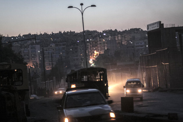 In this Tuesday, Oct. 30, 2012 photo, night falls on a Syrian rebel checkpoint in the Bustan Al-Pasha neighborhood, the boundary of the area controlled by rebel fighters at the northeast limit of the Kurdish controlled area of Sheikh Maksoud in Aleppo, Syria. (AP Photo/Narciso Contreras)