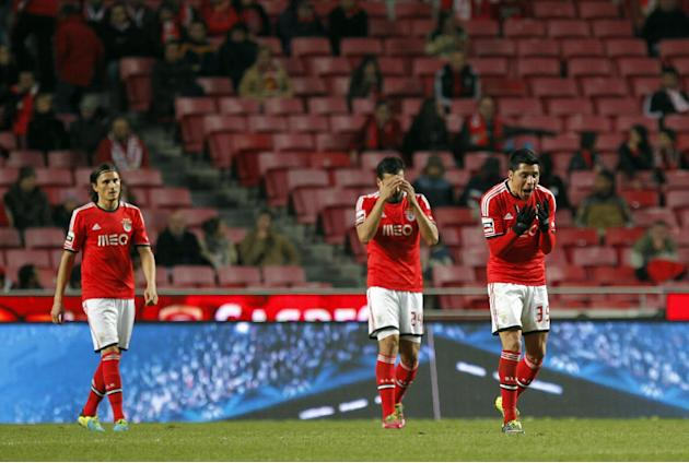 Benfica's Enzo Perez, from Argentina, Ezequiel Garay, also from Argentina, and Fejsa, from Serbia, from right to left, react after Arouca scored their second goal during a Portuguese league soccer