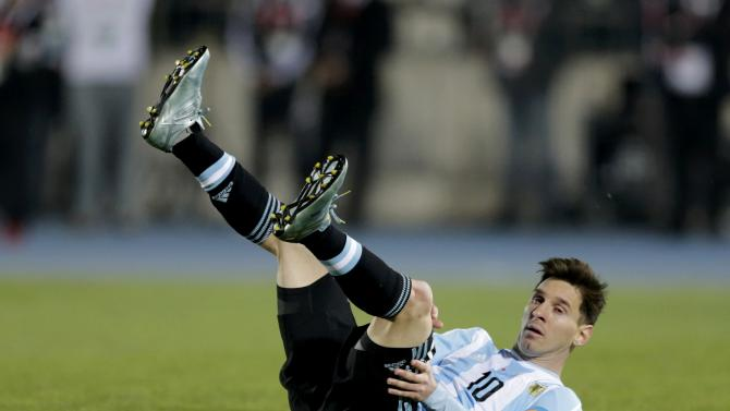Argentina's Lionel Messi falls during the Copa America 2015 final soccer match against Chile at the National Stadium in Santiago
