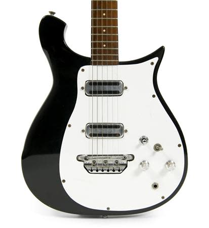 George Harrison's black-and-white 1962 Rickenbacker 425 electric guitar is shown in this handout photo provided by Julien's Auctions