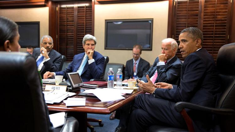 In this image provided by The White House, President Barack Obama meets with his national security staff to discuss the situation in Syria, in the Situation Room of the White House, Friday, Aug. 30, 2013, in Washington, including from left national security adviser Susan Rice; Attorney General Eric Holder, Secretary of State John Kerry, and Vice President Joe Biden. (AP Photo/The White House, Pete Souza)