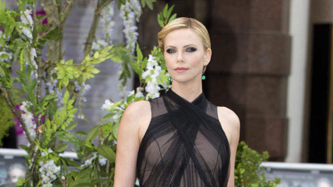 Actress Charlize Theron poses for the media at the World Premiere of the film Snow White and the Huntsman at a cinema in central London, Monday, May14, 2012. (AP Photo/Alastair Grant)