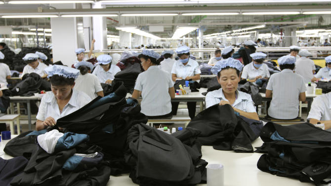 In this Sept. 21, 2012 photo, North Korean workers assemble Western-style suits at the South Korean-run ShinWon Corp. garment factory inside the Kaesong industrial complex in Kaesong, North Korea. On Wednesday, April 3, 2013, North Korea refused entry to South Koreans trying to cross the Demilitarized Zone to get to their jobs managing factories in the North Korean city of Kaesong. Pyongyang had threatened in recent days to close the border in anger over South Korea's support of U.N. sanctions punishing North Korea for conducting a nuclear test in February. (AP Photo/Jean H. Lee)