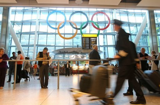 <p>Giant 2012 Olympic rings are unveiled at Heathrow Airport's Terminal 5, west of London, on June 20. Border staff drafted in to cope with the influx of visitors to Britain for the Olympic Games may lack proper training and immigration experience, an independent watchdog warned on Thursday.</p>