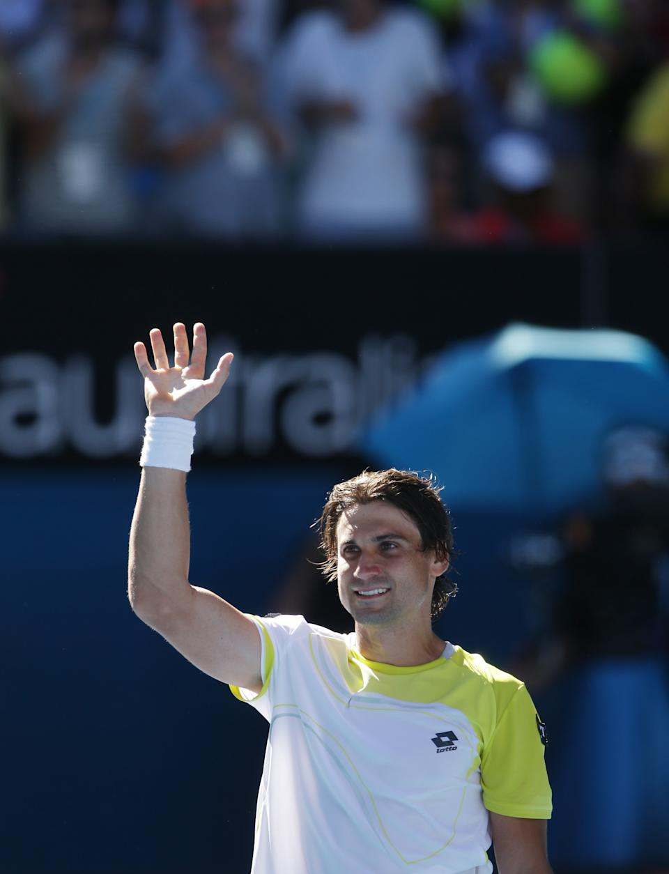 Spain's David Ferrer celebrates after defeating compatriot Nicolas Almagro in their quarterfinal match at the Australian Open tennis championship in Melbourne, Australia, Tuesday, Jan. 22, 2013. (AP Photo/Dita Alangkara)