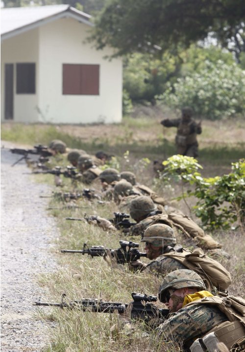 "U.S. Marines participate in an amphibious assault exercise as part of the ""Cobra Gold 2013"" (CG13) joint military exercise at a military base in Chonburi province"