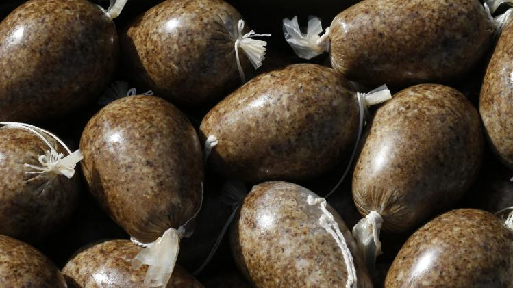 Haggis to be used at the world haggis eating competition sit in a pile before the event at the Birnam Highland Games in Scotland