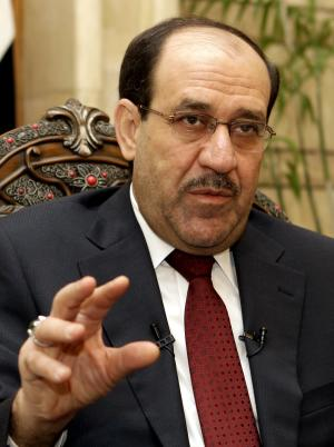FILE - In this Saturday, April 12, 2011 file photo, Iraqi Prime Minister Nouri al-Maliki speaks during an interview with The Associated Press at his office in the heavily protected Green Zone in Baghdad, Iraq. Iraq's prime minister said Saturday, Oct. 22, 2011 that disagreements about legal protection for U.S. soldiers scuttled months of negotiations to keep American troops in Iraq beyond this year. Nouri al-Maliki told reporters that he still wants American help in training Iraqi forces to use military equipment Baghdad is buying from the United States. (AP Photo/Karim Kadim, File)