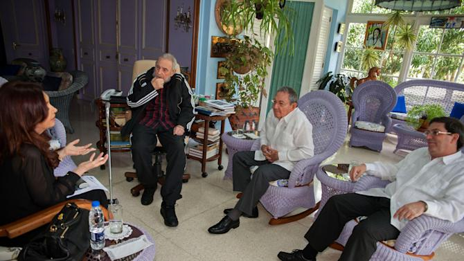 RETRANSMITTED FOR LARGER FILE SIZE AND IMPROVED QUALITY.- In this picture released by Cuba's state newspaper Granma taken Friday Jan. 11, 2013,  Cuba's leader Fidel Castro,  second from left,  Cuba's President Raul Castro, second from right,  and Cuban Foreign Affairs Minister Bruno Rodriguez, right, listen to Argentina's President Cristina Fernandez during a private meeting in Havana, Cuba. Fernandez is in Cuba to visit Venezuela's President Hugo Chavez, who is recovering from cancer surgery.  (AP Photo/Alex Castro, Granma)