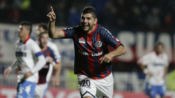 Nestor Ortigoza of Argentina's San Lorenzo celebrates scoring against Paraguay's Nacional during the Copa Libertadores final soccer match in Buenos Aires, Argentina, Wednesday, Aug. 13, 2014. (AP Photo/Natacha Pisarenko)