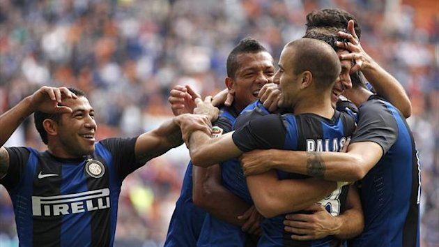 Inter Milan's Rodrigo Palacio celebrates with his team-mates after scoring against Catania (Reuters)