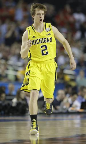 Michigan guard Spike Albrecht (2) reacts against the Louisville during the first half of the NCAA Final Four tournament college basketball championship game Monday, April 8, 2013, in Atlanta. (AP Photo/Charlie Neibergall)