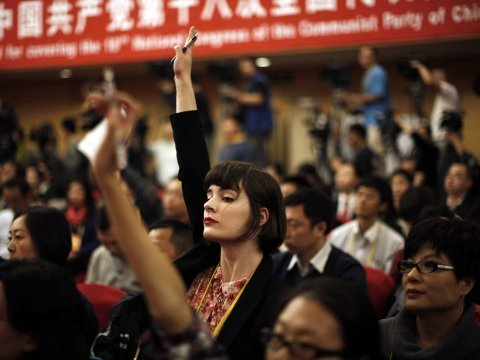 china foreign journalist raise hands