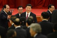 China's Vice President Xi Jinping (centre) attends a National Day reception at the Great Hall of the People in Beijing on September 29. Speculation is mounting over who will be named the new leaders of China's Communist Party as the country's political elite meets ahead of a once-in-a-decade power handover