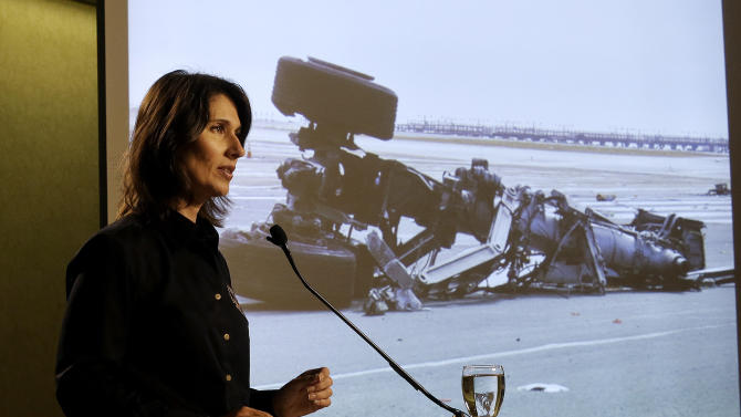Deborah Hersman of the National Transportation Safety Board speaks in front of a photograph of a landing gear on Asiana Flight 214, which crashed on Saturday, July 6, 2013, at San Francisco International Airport, at a news conference in South San Francisco, Calif., Thursday, July 11, 2013. (AP Photo/Jeff Chiu)