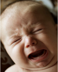 Crying baby at night: let her cry it out or go and hold her? A new study says it's okay to let her cry it out.