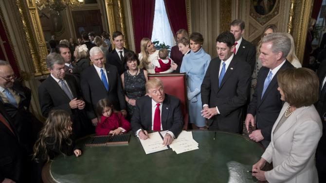 President Donald Trump is joined by the Congressional leadership and his family as he formally signs his cabinet nominations into law, in the President's Room of the Senate in Washington