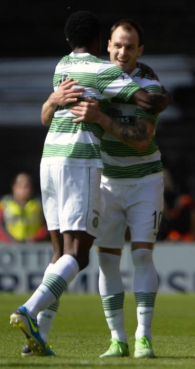 Celtic's Stokes celebrates his goal against Dundee United during their Scottish Premier League soccer match in Dundee, Scotland