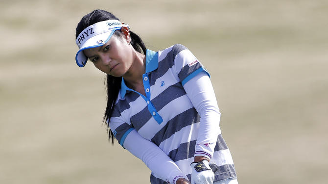 CORRECTS CITY TO PHOENIX, NOT SCOTTSDALE - Ai Miyazato, of Japan, chips onto the 18th green during the second round of the Founders Cup golf tournament, Friday, March 15, 2013, in Phoenix.  (AP Photo/Matt York)