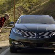"""This undated screenshot provided by Ford shows the company's Super Bowl advertisement. Ford Motor Co. enlisted late-night talk show host Jimmy Fallon to choose road trip stories submitted by Twitter  to base its Super Bowl commercial for Lincoln. The story line for the 30-second ad was developed from 6,117 Tweets about road trips and features rapper Joseph """"Rev Run"""" Simmons, and Wil Wheaton, who acted in the iconic science-fiction series """"Star Trek: The Next Generation..""""( AP Photo/Ford)"""