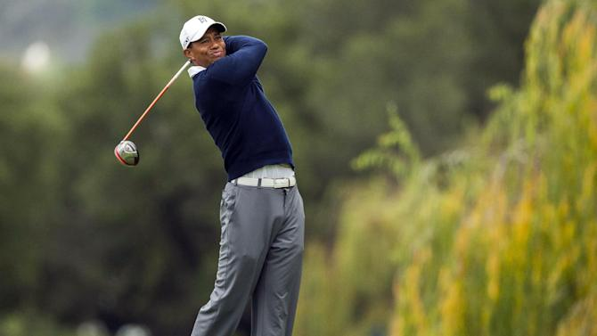 Tiger Woods tees off on the fifth hole during the first round of the World Challenge golf tournament at Sherwood Country Club in Thousand Oaks, Calif., Thursday, Nov. 29, 2012. (AP Photo/Bret Hartman)