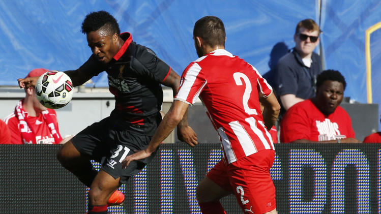IMAGE DISTRIBUTED FOR GUINNESS INTERNATIONAL CHAMPIONS CUP - Lliverpool FC's Raheem Sterling controls a ball in front of Olympiacos' Ionnis Maniatis (2) during the 2014 Guinness International Champions Cup, on Sunday, July 27, 2014 in Chicago, Ill. Liverpool FC defeated Olympiacos FC 1-0. )Ross Dettman/AP Images for Guinness International Champions Cup)