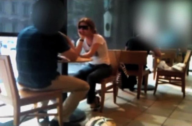 In this frame grab image from a surveillance video released by the Federal Bureau of Investigation (FBI), and partially obscured by the source, Russian spy Anna Chapman, wearing sunglasses, sits in a