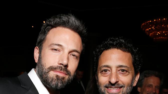 IMAGE DISTRIBUTED FOR THE PRODUCERS GUILD - Ben Affleck, left, and Grant Heslov pose in the audience at the 24th Annual Producers Guild (PGA) Awards at the Beverly Hilton Hotel on Saturday Jan. 26, 2013, in Beverly Hills, Calif. (Photo by Todd Williamson/Invision for Producers Guild/AP Images)