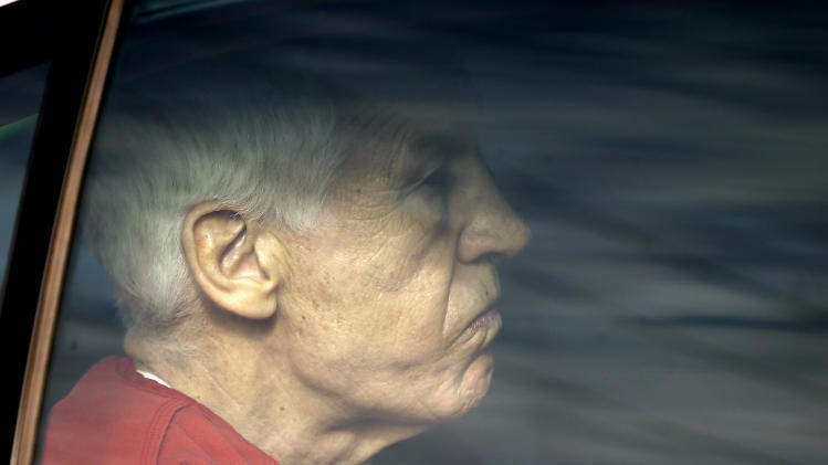 Former Penn State University assistant football coach Jerry Sandusky is driven from the Centre County Courthouse after being sentenced in Bellefonte, Pa., Tuesday, Oct. 9, 2012. Sandusky was sentenced to at least 30 years in prison, effectively a life sentence, in the child sexual abuse scandal that brought shame to Penn State and led to coach Joe Paterno's downfall. (AP Photo/Matt Rourke)