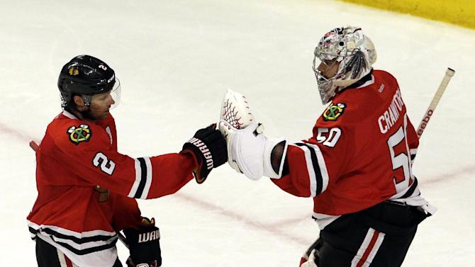 Chicago Blackhawks defenseman Duncan Keith, left, celebrates with goalie Corey Crawford after scoring his goal against the Nashville Predators during the third period in Game 6 of an NHL Western Conference hockey playoff series Saturday, April 25, 2015, in Chicago. (AP Photo/Nam Y. Huh)