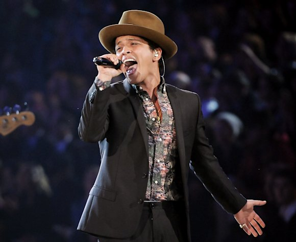 FILE - This Nov. 7, 2012 file photo shows Bruno Mars performing during the 2012 Victoria&#39;s Secret Fashion Show in New York. Mars is releasing his sophomore album, Unorthodox Jukebox,&quot; featuring Grammy-winning jazz singer Esperanza Spalding and production and songwriting work by Mark Ronson, Jeff Bhasker, Diplo, Paul Epworth, Emile Haynie and the Smeezingtons, the production trio that includes Mars, Philip Lawrence and Ari Levine. (Photo by Evan Agostini/Invision/AP)