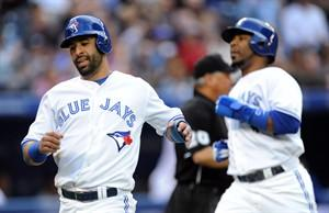 Toronto Blue Jays' Jose Bautista, left, and Edwin Encarnacion score on error by San Francisco Giants center fielder Angel Pagan during first-inning AL baseball game action in Toronto, Wednesday, May 15, 2013. (AP Photo/The Canadian Press, Frank Gunn)