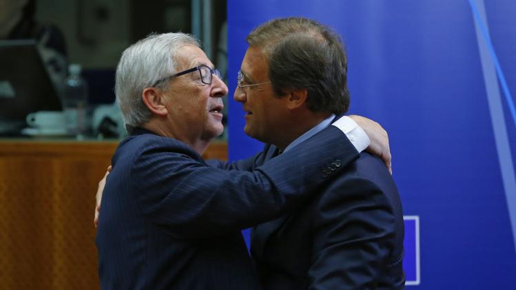 Portugal's PM Passos Coelho talks with newly elected European Commission President Juncker at the start of a European Union summit in Brussels