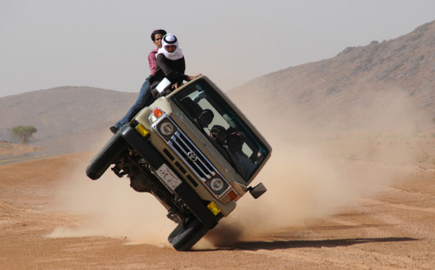 "Saudi youths demonstrate stunt known as ""sidewall skiing"" in the northern city of Hail"