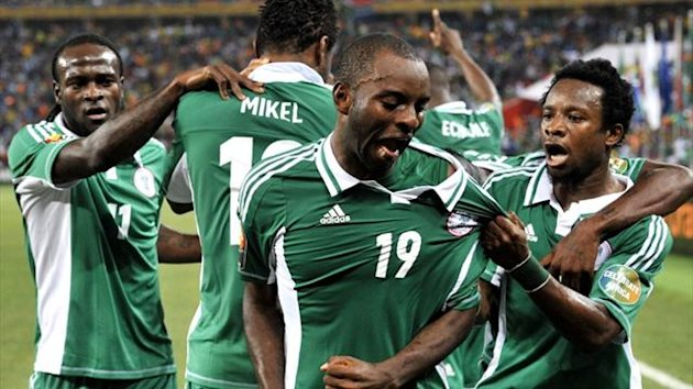 Nigeria's Sunday Mba and team-mates celebrate in the final (AFP)