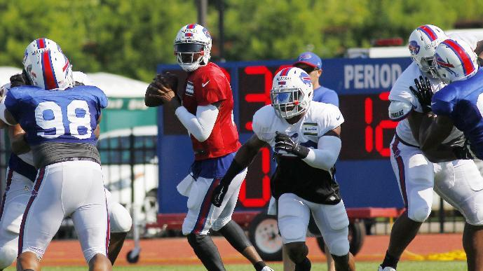 Buffalo Bills quarterback EJ Manuel (3) and running back Fred Jackson (22) run a play during NFL football training camp in Pittsford, N.Y., Tuesday, July 22, 2014