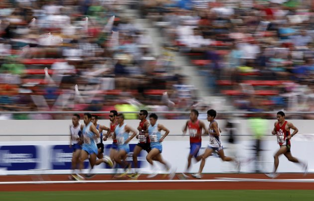 Runners compete in the men's 5000m final at the Central American Games in San Jose