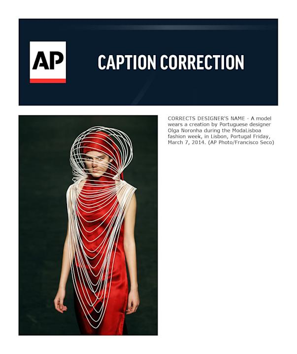 CORRECTS DESIGNER'S NAME - A model wears a creation by Portuguese designer Olga Noronha during the ModaLisboa fashion week, in Lisbon, Portugal Friday, March 7, 2014. (AP Photo/Francisco Seco)