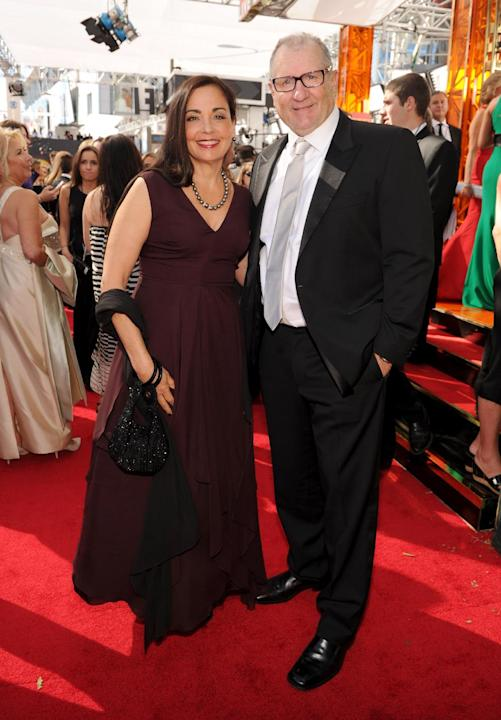 Ed O'Neill, right, and Catherine Rusoff arrive at the 65th Primetime Emmy Awards at Nokia Theatre on Sunday Sept. 22, 2013, in Los Angeles. (Photo by Frank Micelotta/Invision for Academy of Televi