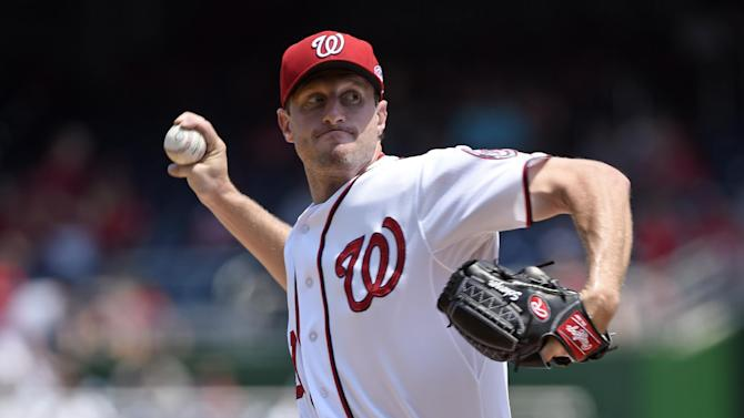 Washington Nationals starting pitcher Max Scherzer delivers a pitch against the Miami Marlins during the first inning of their baseball game at Nationals Park in Washington, Wednesday, May 6, 2015. (AP Photo/Susan Walsh)