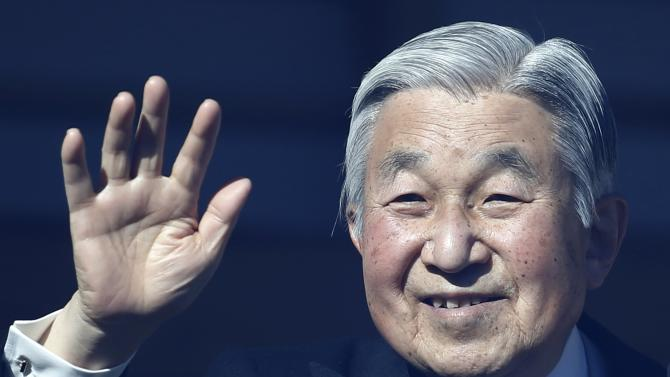 Japan's Emperor Akihito waves to well-wishers gathered to celebrate his 81st birthday at the Imperial Palace in Tokyo