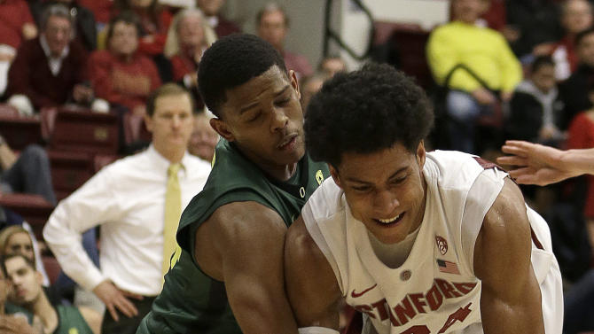 Oregon's Johnathan Loyd, left, and Stanford's Josh Huestis go after a loose ball during the second half of an NCAA college basketball game Wednesday, Jan. 30, 2013, in Stanford, Calif. (AP Photo/Ben Margot)