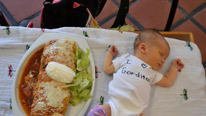A baby is pictured next to a Gorditos burrito. Apparently the baby loves the restaurant.